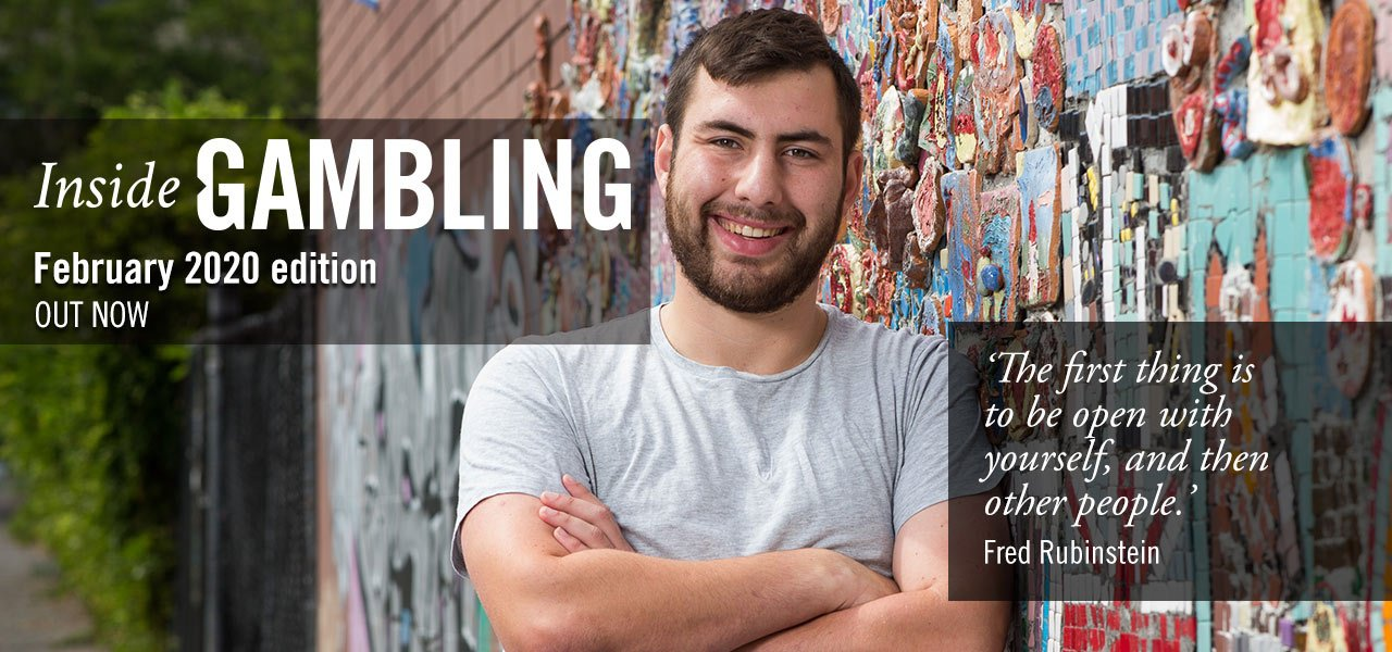 Smiling young man with brown hair and beard, wearing a T-shirt, leaning, arms folded, against a wall. Overlay text: Inside gambling February 2020 edition out now. 'The first thing is to be open with yourself, and then other people.' Fred Rubinstein