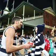 Geelong Cats' Harry Taylor chats with a young fan.
