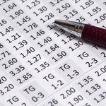 Closeup of a pen on a paper with numbers