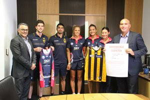Foundation CEO Serge Sardo, Hawthorn FC stars Luke Breust and Bradley Hill, Melbourne Vixens netballers Madi Robinson, Liz Watson and Kate Moloney, and Hawthorn FC CEO Stuart Fox.