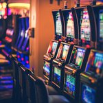 Rows of pokie machines with shallow depth of field.