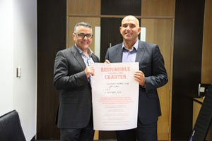 Foundation CEO Serge Sardo & Hawthorn FC CEO Stuart Fox with the responsible gambling charter.