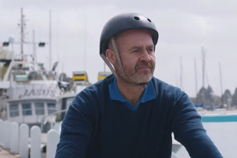 A cyclist on his bicycle on the pier