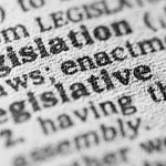 Close up of the definition of legislation in a dictionary