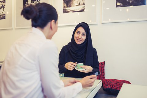 Muslim woman chatting over coffee